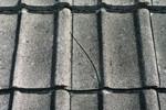 Dislodged,cracked, broken, dented or damaged tiles