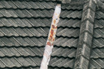 Rust or damage, particularly around the flashings and fixings